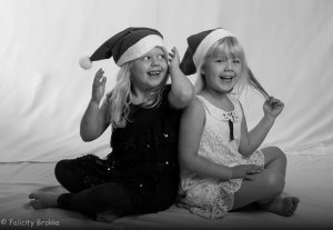 Two girls with christmas hats, black and white