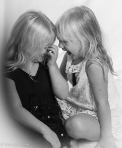 Black and white picture of two girls laughing